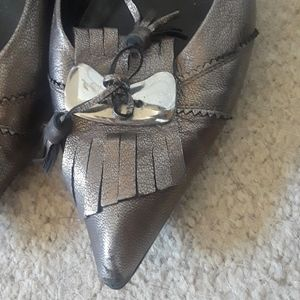 Silver shoes black ones